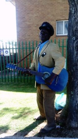 Praise songs just sound better when played on a blue guitar. And utterly from the heart.